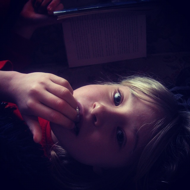 little girl reading instagram