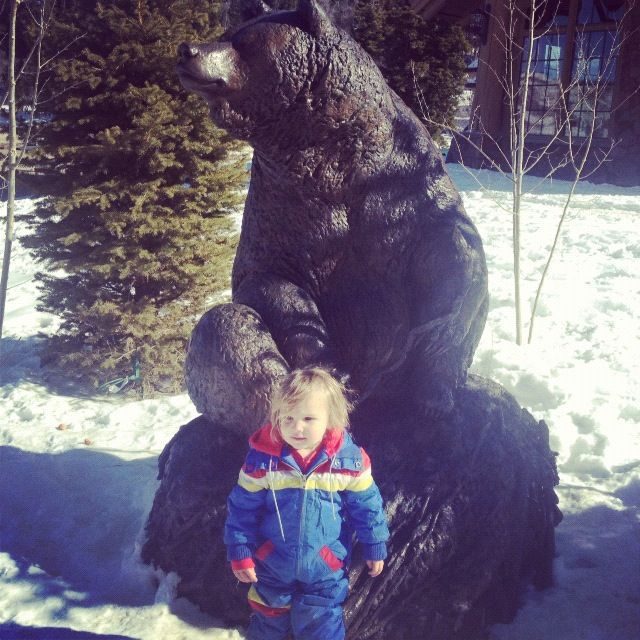 little boy snowsuit bear sculpture instagram