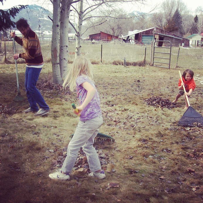 dad little kids working in yard raking leaves instagram