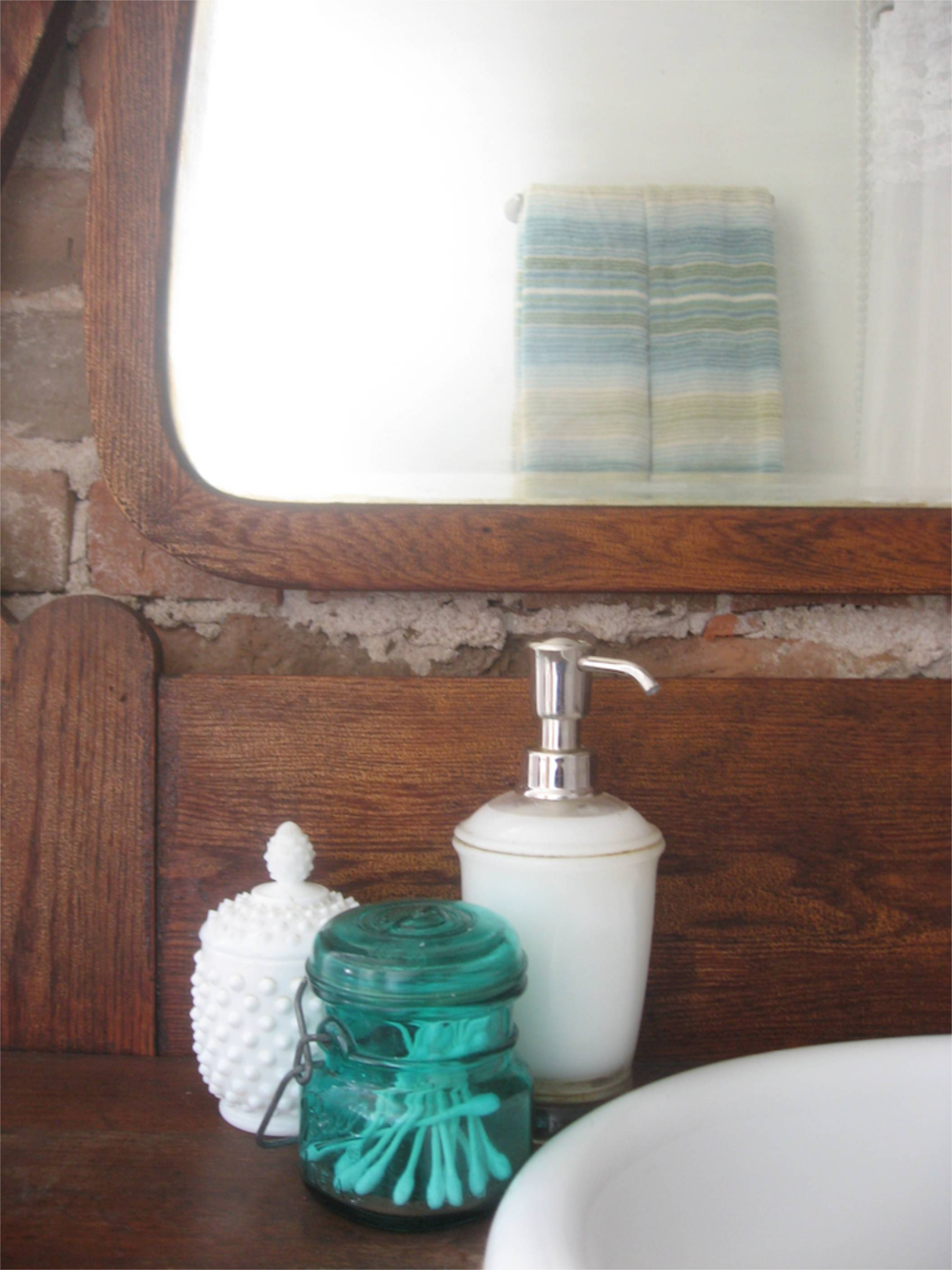 brick wall antique vanity penny tile bathroom