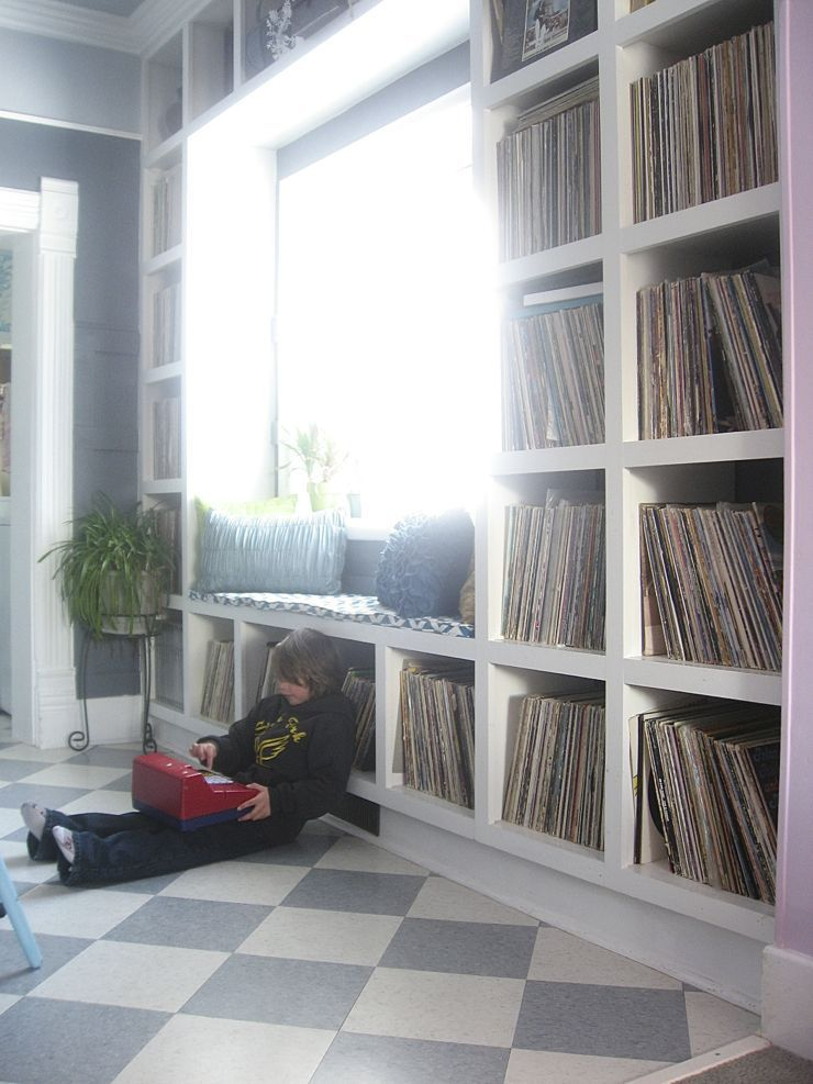 built-in shelves window seat records