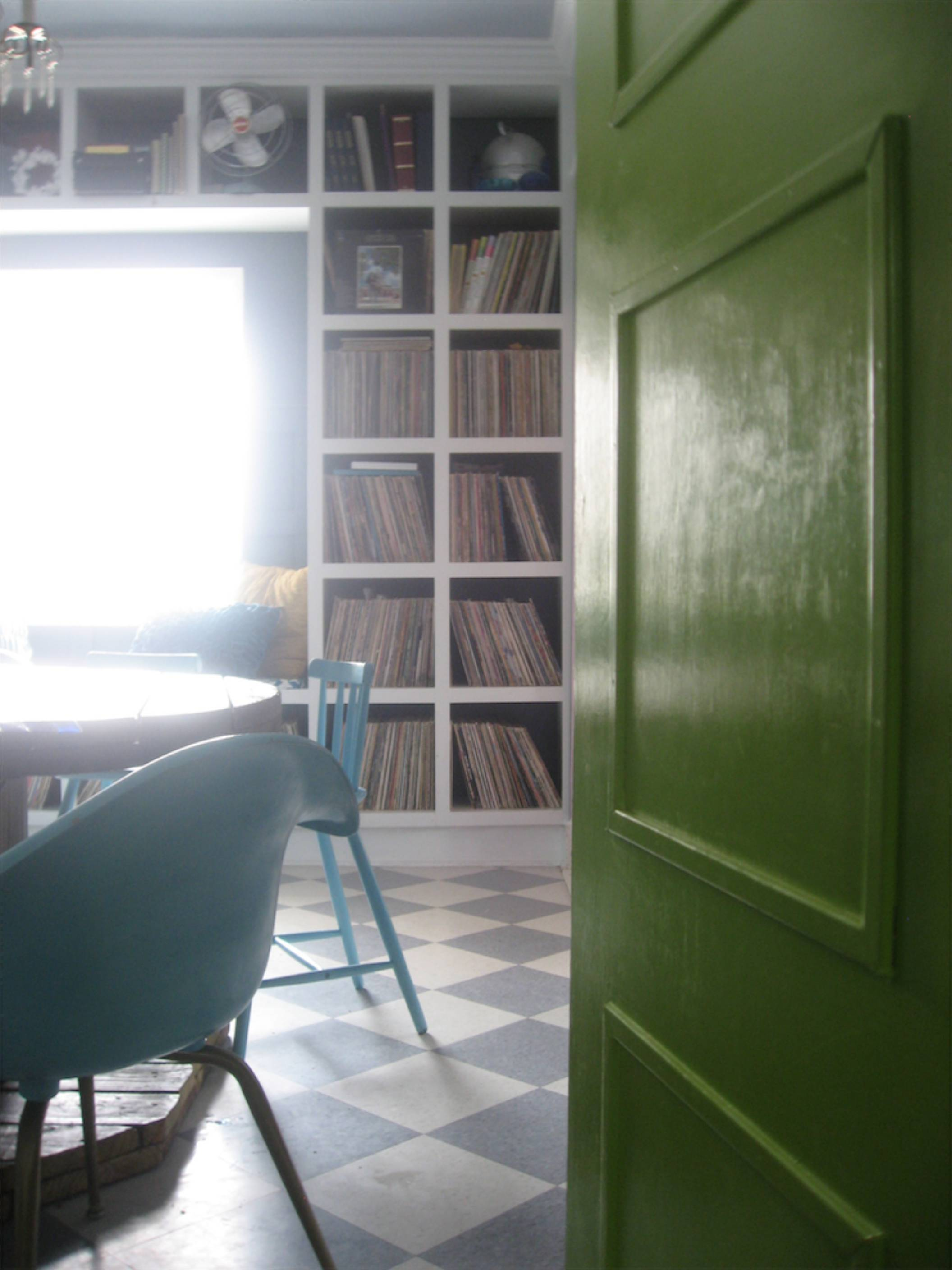 built-in shelves window seat records chartreuse door