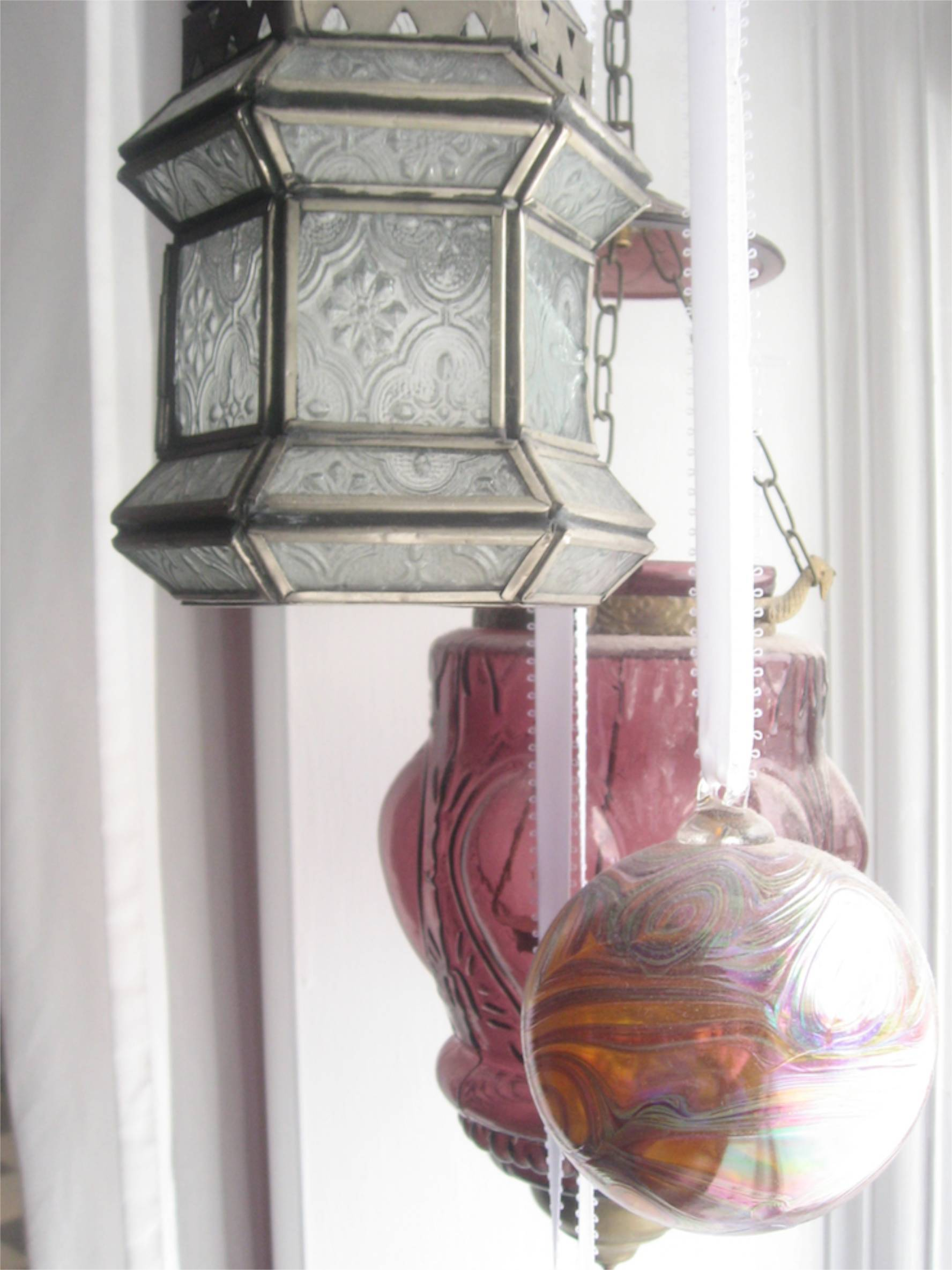 lanterns and glass balls in window