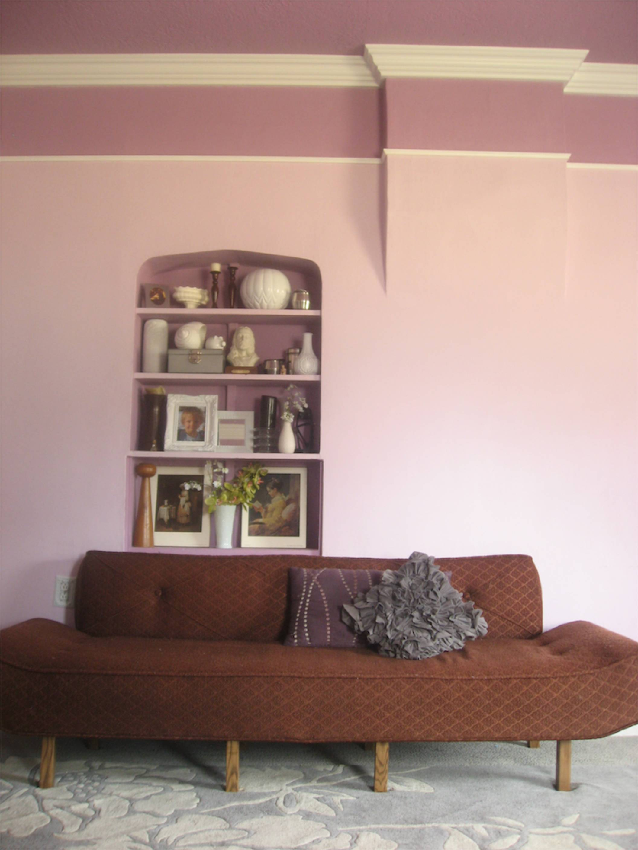 purple living room crown molding picture rail