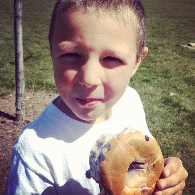 little boy eating bagel instagram