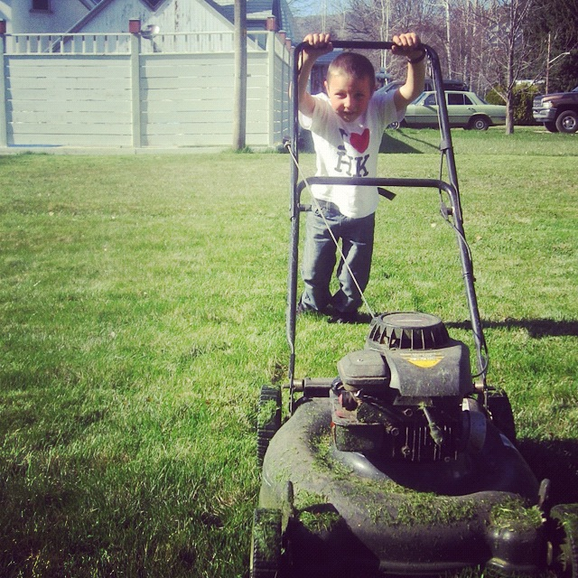 little boy pushing mower instagram