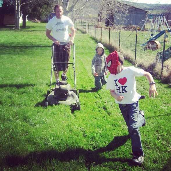little boys watching dad mow lawn instagram