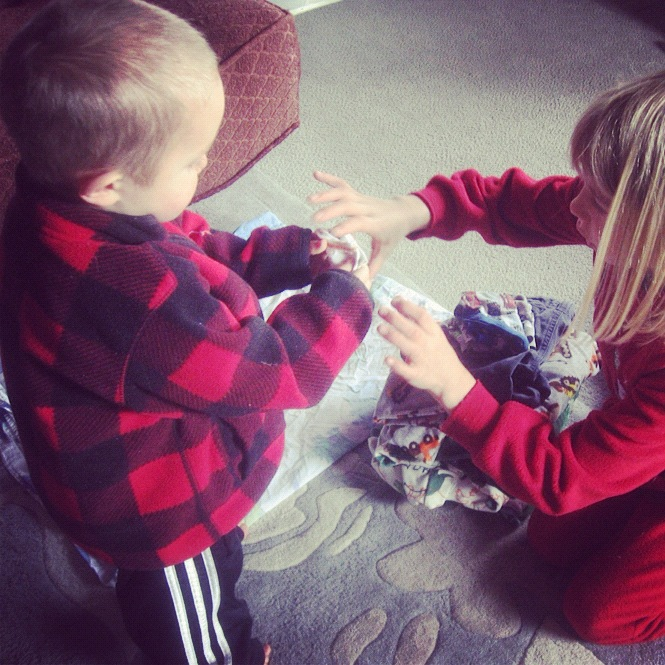 little boy and girl folding laundry instagram