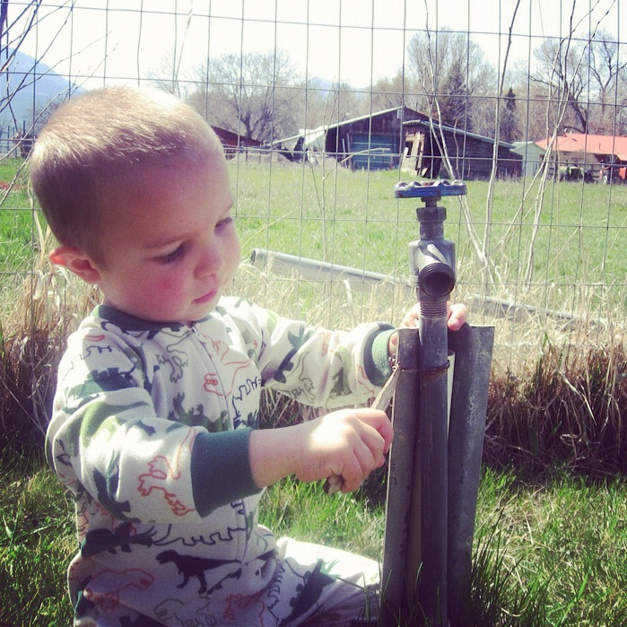little boy pajamas fixing sprinkler instagram